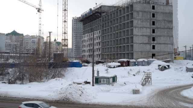 few tall buildings under construction and cranes - autoclave video stock e b–roll