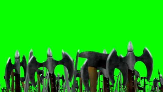 vídeos de stock e filmes b-roll de few warriors waving up their weapons with axes and swords on a green screen background - escudo