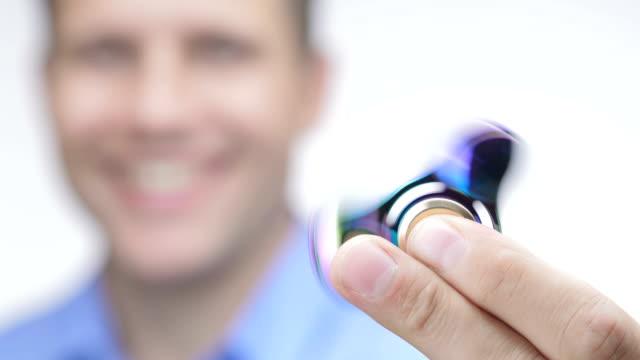 Fidget spinner rotating on hand. video