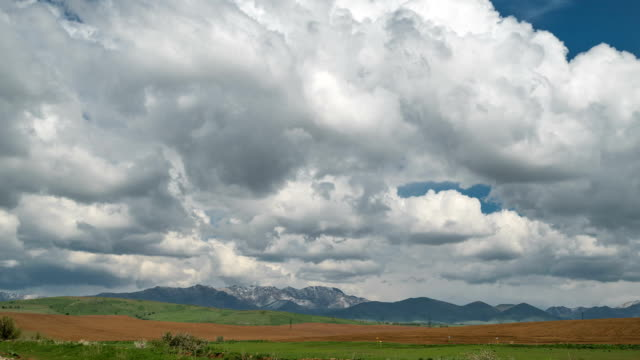 Fields and storm clouds over mountains. Timelapse FullHD Fields and storm clouds over mountains. Timelapse FullHD kazakhstan stock videos & royalty-free footage