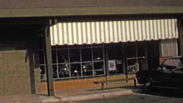 1974: Fifth Avenue Florists building front public facing open store. video