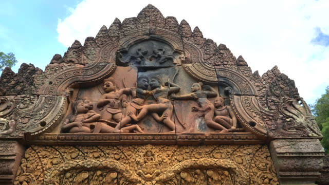 fight scene on west pediment of banteay srei temple angkor