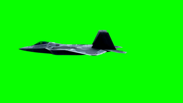 f-22 fighter jet, flying over city on green screen - samolot myśliwski filmów i materiałów b-roll