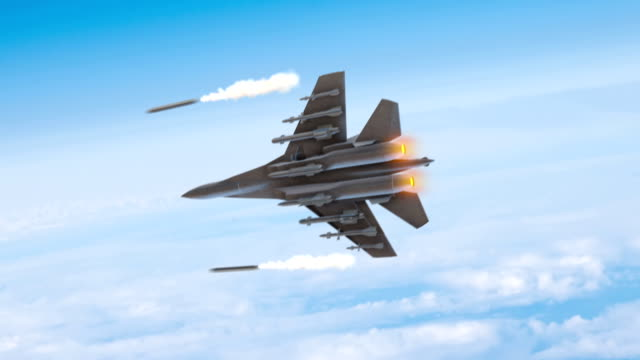 Fighter Plane Flying High Above The Clouds Then Fires Missiles