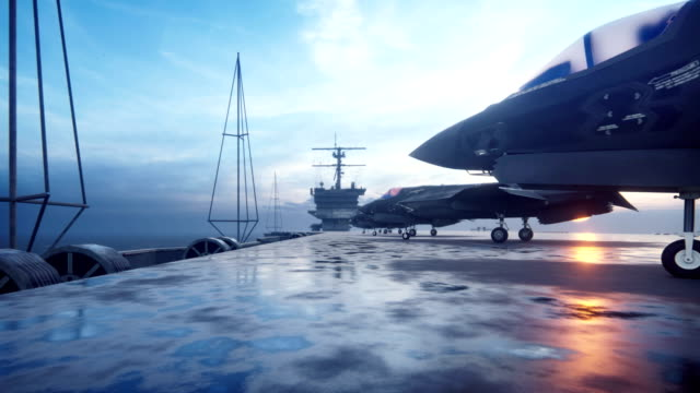 F-35 fighters are on the aircraft carrier ready to fly.
