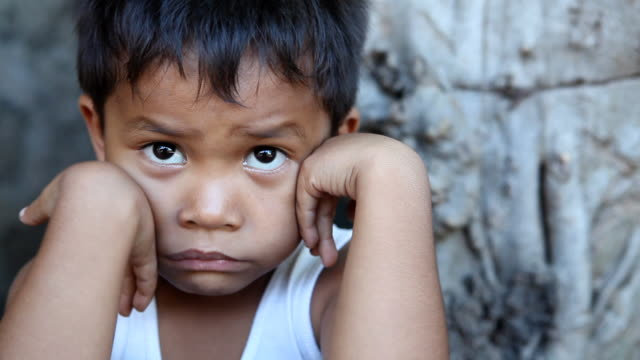 HD Filipino boy portrait  poverty stock videos & royalty-free footage