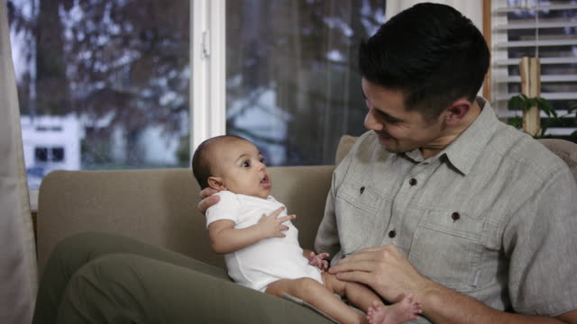 Filipino Father Lovingly Holding his Mixed-Race Baby Girl video