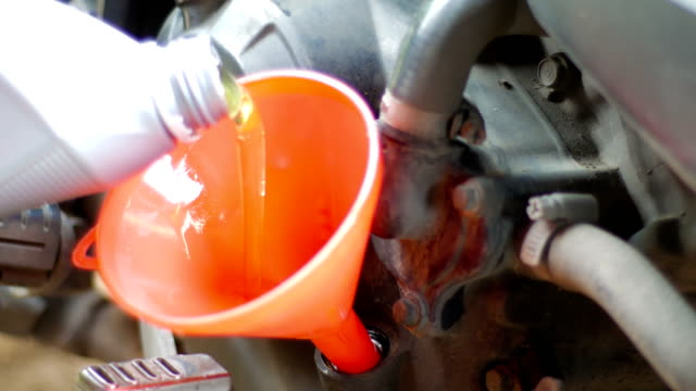 Fill lubricant oil to motorcycle engine, maintenance service video