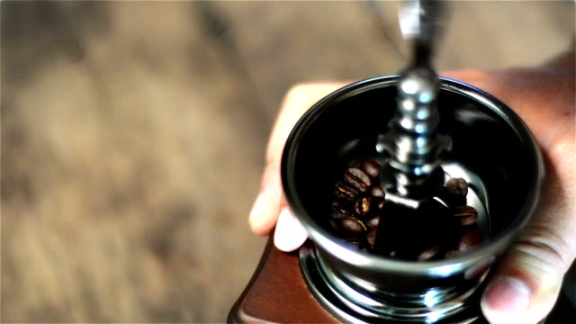 Filled coffee beans into coffee grinder and grinds coffee bean. video