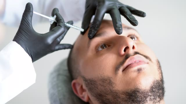 filler injection for male face in beauty clinic - collagene video stock e b–roll