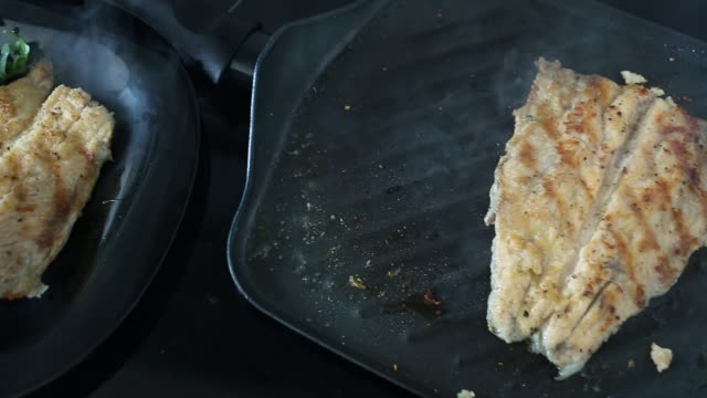 Fillet fried in  pan Fillet of river trout fried in  pan fillet stock videos & royalty-free footage