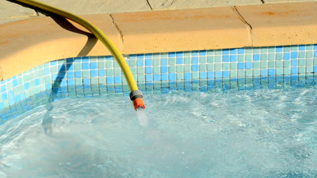 filling a pool with water video