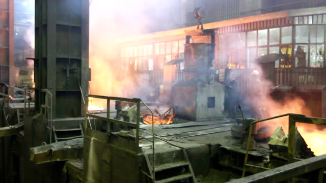 Filling blast furnace with old metal for recycling video