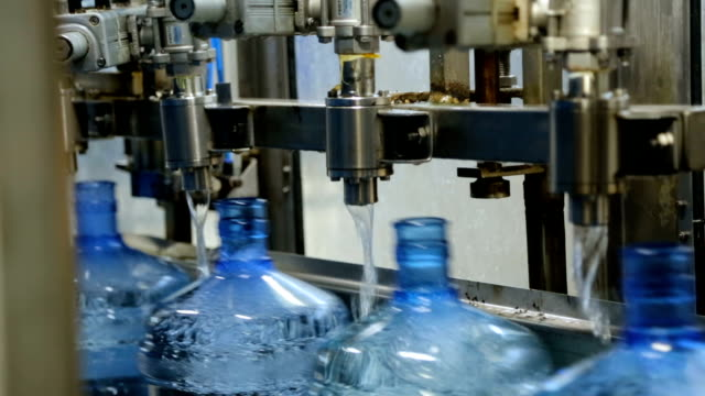 Filling Bottle with Water in Factory