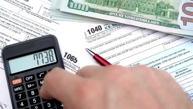 filling out tax forms. high angle view. - zwrot filmów i materiałów b-roll