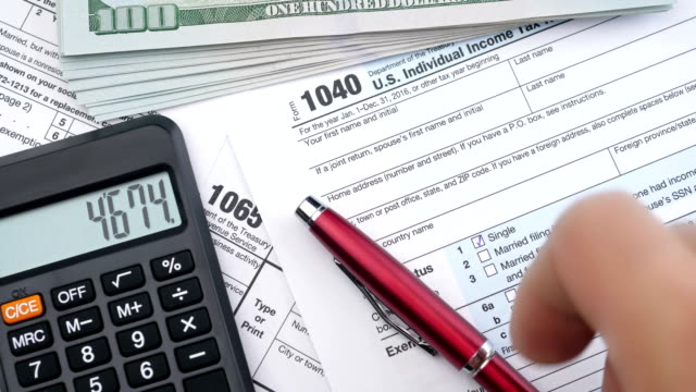 filling out tax forms. high angle view. - politica e governo video stock e b–roll