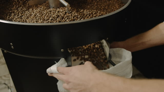 Filling the bag with coffee slow motion 4K video