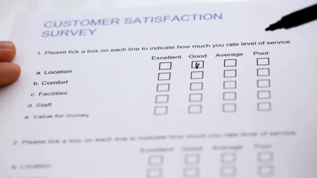 Filling The Customer Satisfaction Survey Form Close-up Of A Person's Hand Filling Customer Satisfaction Survey Form survey stock videos & royalty-free footage