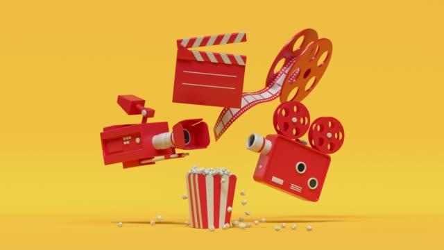 stockvideo's en b-roll-footage met film camera popcorn rood geel cartoon stijl minimaal 3d rendering cinema theater concept - popcorn