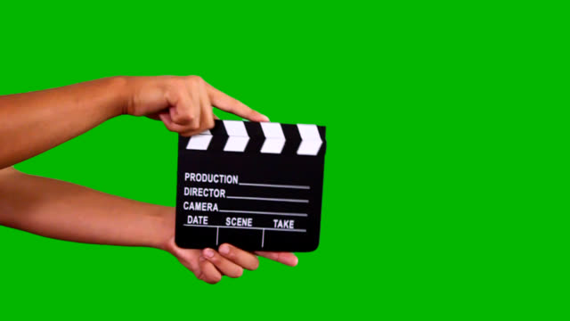 Film clapboard Hand clapping film clapboard shot on green chroma key. Contains alpha matte. actor stock videos & royalty-free footage