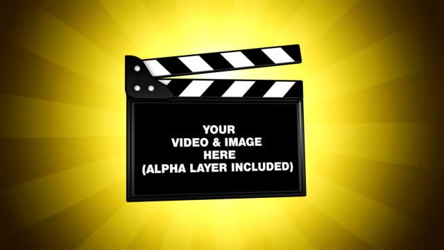vidéos et rushes de film clapper boîte verte-changer - ardoise