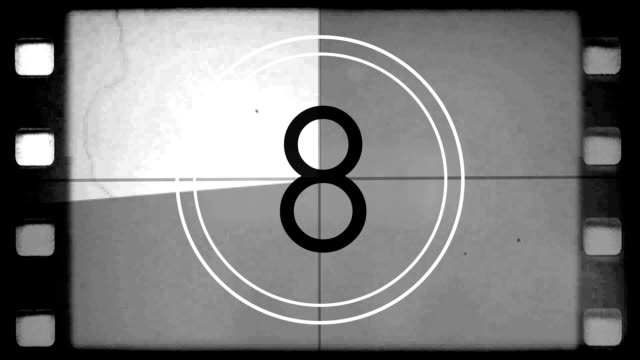 Film Countdown Leader Old black and white film countdown leader with film dust, scratches, hairs, and flickers film reel stock videos & royalty-free footage