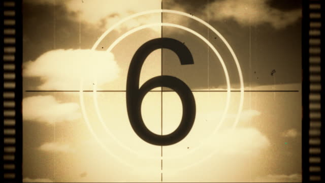 Film leader Countdown with strips and fast moving clouds. sepia toned stock videos & royalty-free footage