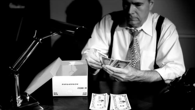 Film Noir Man Putting Money in a Shoe Box video