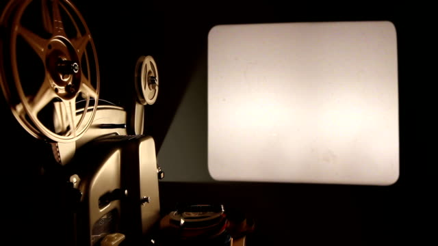 vidéos et rushes de projecteur et écran vide - cinéma