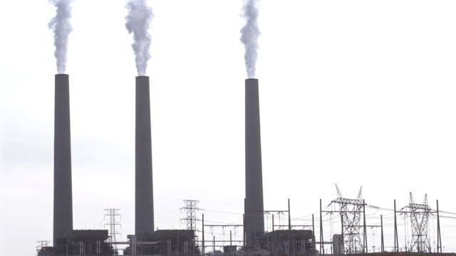 Film Tilt Smoke from Chimney tower of Thermal coal Power plant in Page Arizona USA