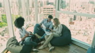 istock Film tilt video of relaxed Businesspeople Brainstorming in Buenos Aires Office 1198475565