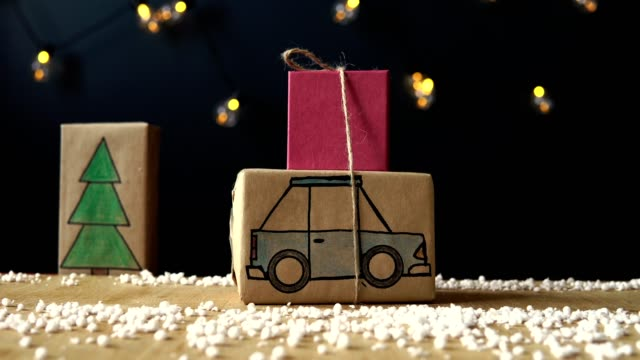Filmed in stop motion. machine Car Christmas gift is coming home through the city