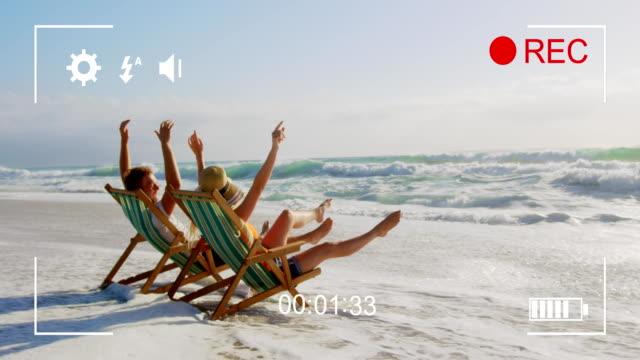 filma ett par på en strand på en digitalkamera 4k - moods vector boy bildbanksvideor och videomaterial från bakom kulisserna