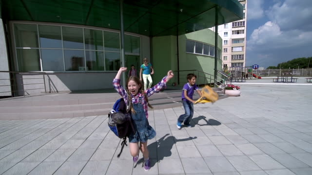 Finally It Is Over Kids approaching camera running away from school and throwing their bags in the air triumphantly test results stock videos & royalty-free footage