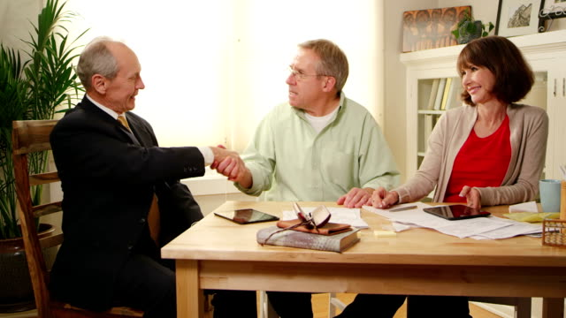 financial adviser helps seniors with bills - baby boomers stock videos & royalty-free footage