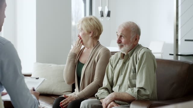 Financial advisor trying to explaing something to mature couple but in a boring way video