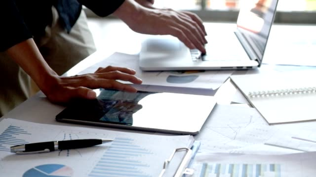 Financial analysts Meeting charts and graphs on the screen of the touchpad Financial analysts Meeting charts and graphs on the screen of the touchpad seo stock videos & royalty-free footage