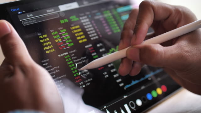 financial analyzing see on stock market date with digital tablet - criptovaluta video stock e b–roll