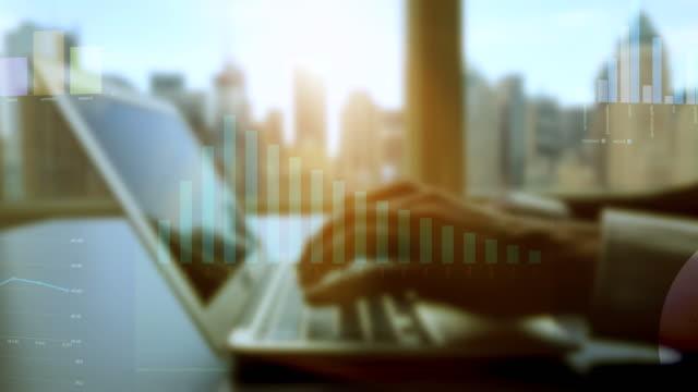 ekonomiska data med diagram, grafer och diagram. moderna kontors bakgrund med stadens silhuett - accounting bildbanksvideor och videomaterial från bakom kulisserna