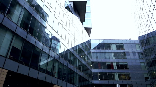 Financial district in a modern city v6. Modern office buildings in a financial district. office park stock videos & royalty-free footage