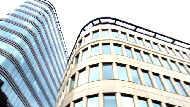 Financial district in a modern city Modern office buildings in a financial district. office park stock videos & royalty-free footage