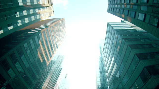 Financial district skyscrapers and buildings. A high angle tour of the Financial district of a large city. financial building stock videos & royalty-free footage