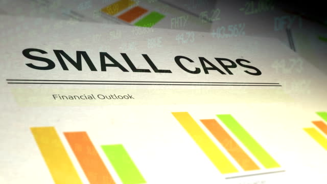 Financial Paperwork with Stock Market Ticker overlay - Small Caps