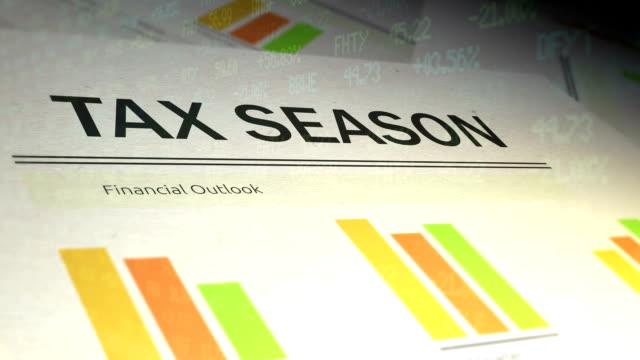 Financial Paperwork with Stock Market Ticker overlay - Tax Season video