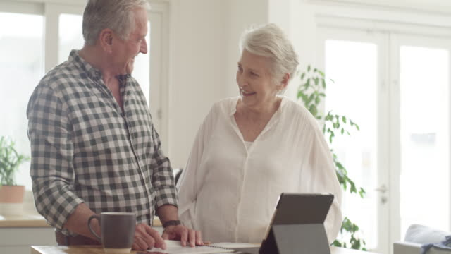 Financial planning keeps their future secure 4k video footage of a senior couple going through paperwork at home financial planning stock videos & royalty-free footage