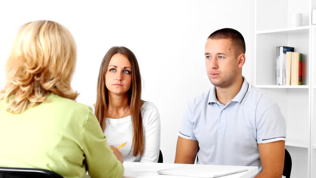 Financial planning Young couple getting advice of a new investment  from  mature  financial consultant woman. financial planning stock videos & royalty-free footage