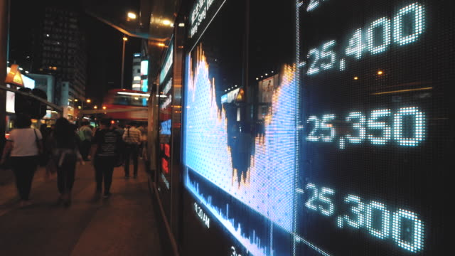 financial stock market numbers and city light reflection, timelapse - табло котировок стоковые видео и кадры b-roll