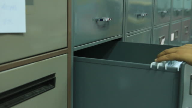 Find the document in cabinet video