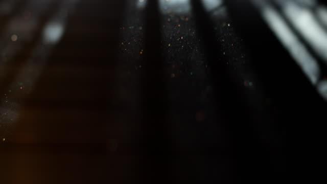 fine dust sparkles in the light - pył filmów i materiałów b-roll
