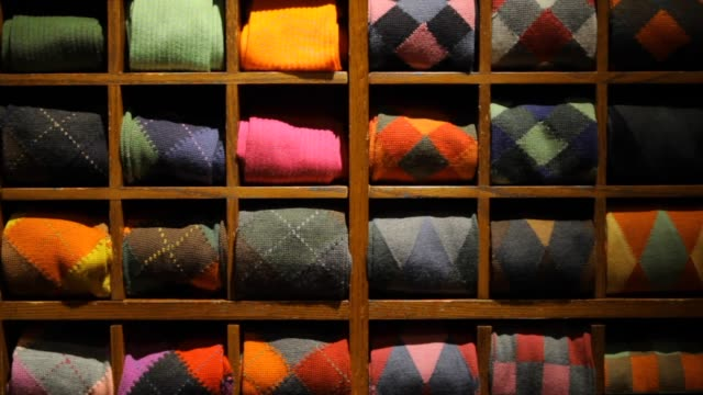 Fine Men's Clothing - Wall of Folded Sweaters Fine Men's Clothing - Wall of Folded Sweaters choice stock videos & royalty-free footage